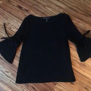 Black bell sleeved knit top with ties on sleeves
